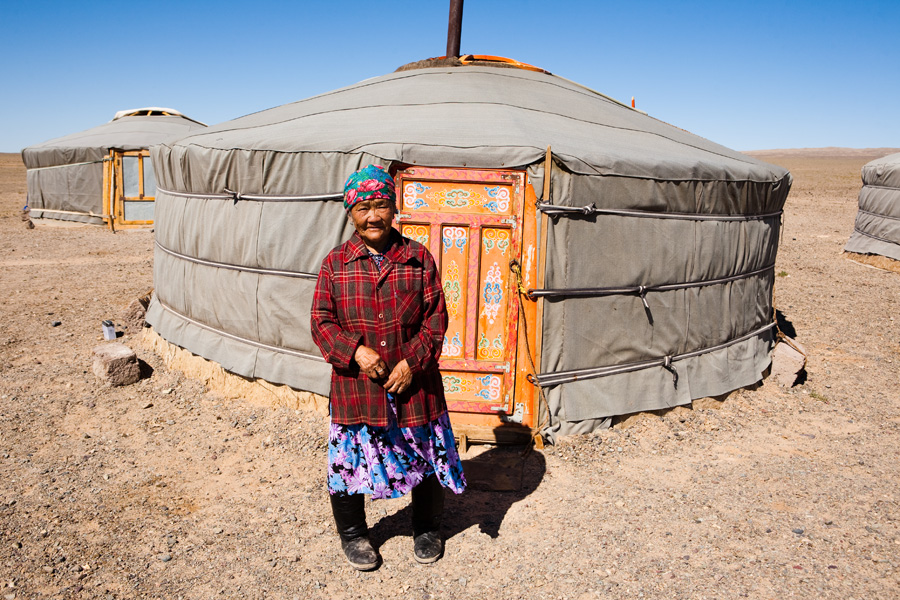 Old woman in front of a yurt in Mongolia